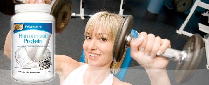 fit woman with dumbells with progressive harmonized protein