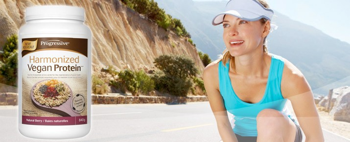woman running through the mountains with progressive harmonized vegan protein